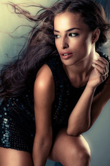 beautiful young woman with long flying hair