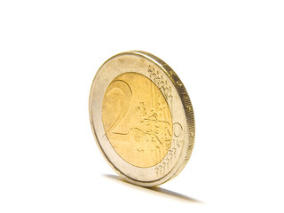 Two euro coin in front of a white background/isolated