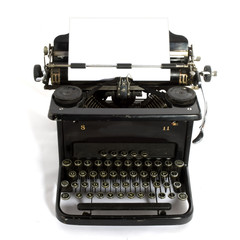 black old-fashioned typewriter with white paper for your text