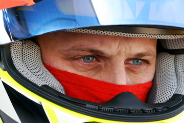 glance concentrated of a racing driver of car