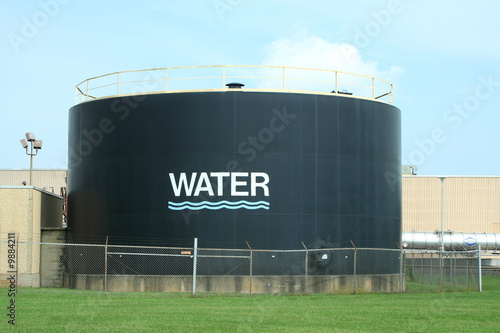 A Water tank agains blue sky - 9884211