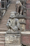 Statues on the steps of a Hindu Temple in Nepal poster