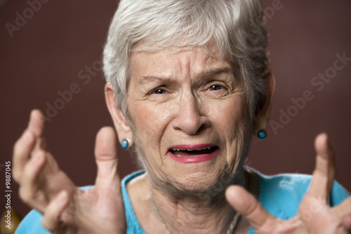Upset senior with a worried expression on her face