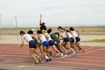 Start of the women's 1500 meter run during a college track meet.