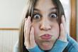 Teenage girl making face