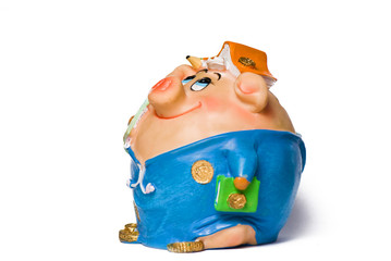 funny pig money-box on the white isolated background