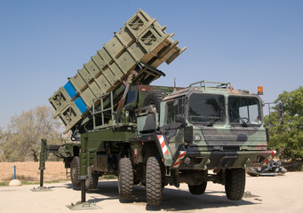 Anti-aircraft ground-air missile system on heavy vehicle.