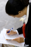 businesswoman is writing notes and planning her schedule. poster