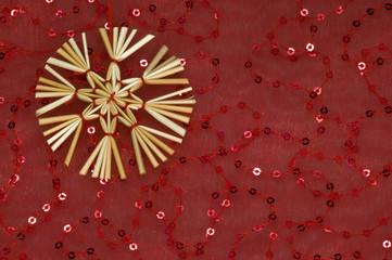 Straw star on red background