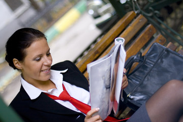 businesswoman reading magazine