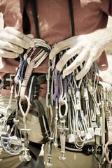 A rock climber organizies his equipment.