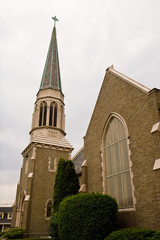 The front of an old presbyterian church and steeple