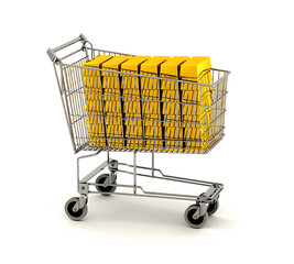 Shopping cart full of gold bars over white background
