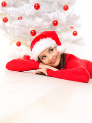 Beautiful woman next to christmas tree wearing red sweater