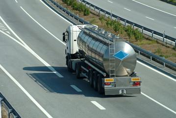 Large tanker truck rolling on highway