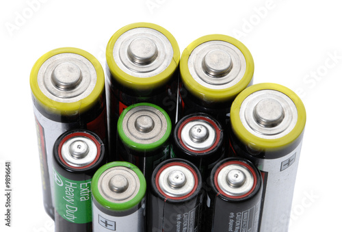 Several AA  batteries on white background energy concept