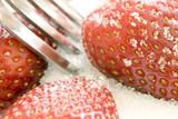 ripe red strawberries covered in sugar granules poster