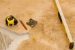 Tools on tile floor - travertine-