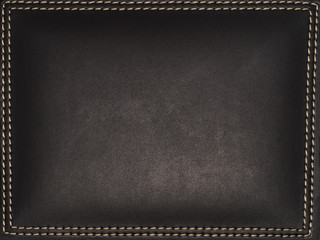 A dark leather frame with surrounding stitches