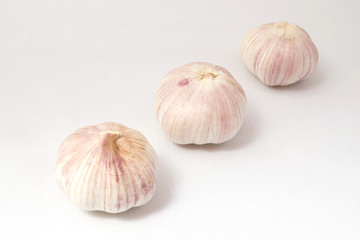 Garlic on white cloth, isolated