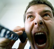 Portrait of angry stressed businessman screaming at the phone