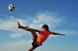 Young boy playing football - low angle virw