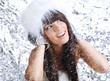 sexy winter girl wearing white fur. blue frozen background