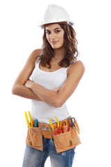 Pretty girl with helmet and belt of tools isolation