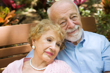Beautiful senior couple relaxing and reminiscing