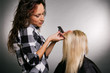 beautiful hairdresser working with blonde
