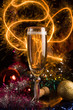 New Year card with champagne glass on holiday background