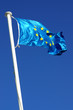 Flag of the european union over a deep blue sky