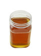 open jar of honey on white background
