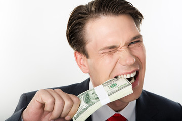 Close-up of strange businessman biting dollars