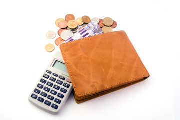 Wallet with money and calculator isolated on white background