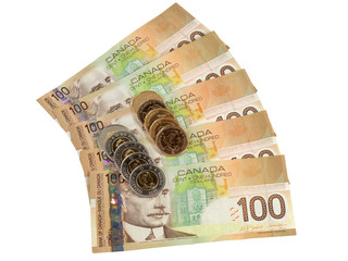Canadian $100 bills with loonies and toonies on top