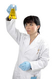 A female scientist observing a chemical in a laboratory  flask. poster