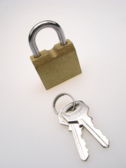 closed hinged lock with keys laying by  line on