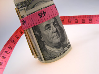Dollars and measure ruler, closeup
