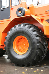 wheeled tractor of high-powered of orange color