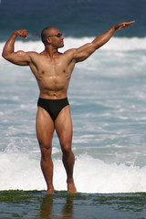 bodybuilder on a beach