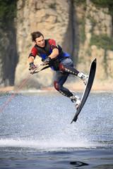 wakeboarder jump in water splash