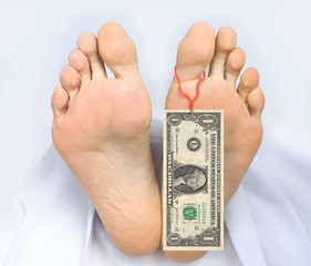 Two feet of  dead body, with banknote one dollar attached
