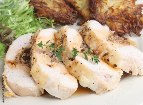 Stuffed chicken breast with potato rosti and gravy