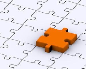 Last orange piece to complete jigsaw puzzle