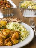 Plate Of Indian Take Away- Chicken Bhoona, Sag Aloo, Pilau Rice