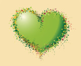 Green heart made of flowers - spring background