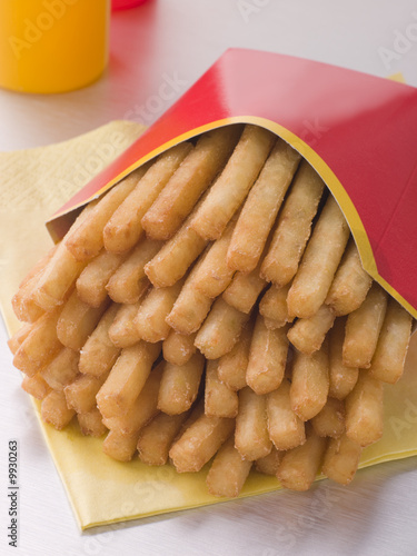 French Fries In A Box With Sauce Bottles