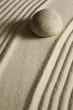 Leinwandbild Motiv Stone on raked sand