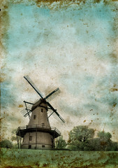 Windmill on a grunge background with copy-space